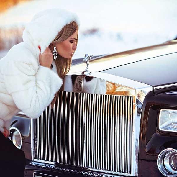 elegant girl next to an expensive car