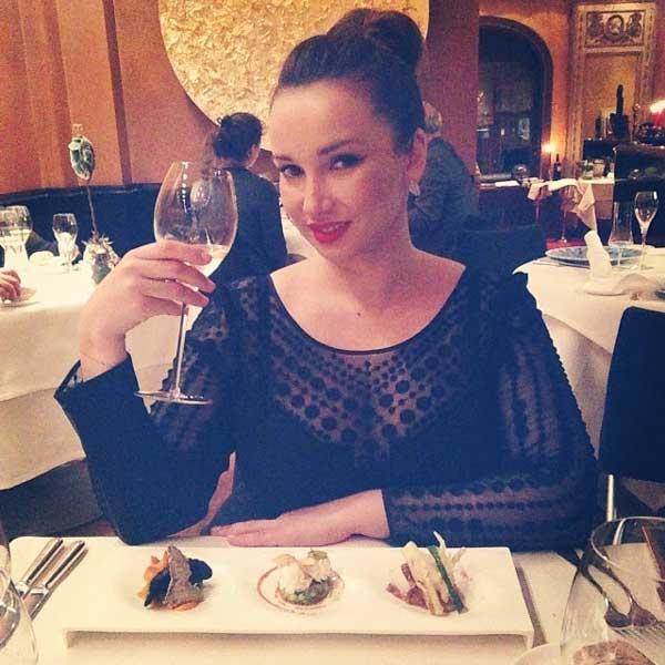 elegant woman at dinner table