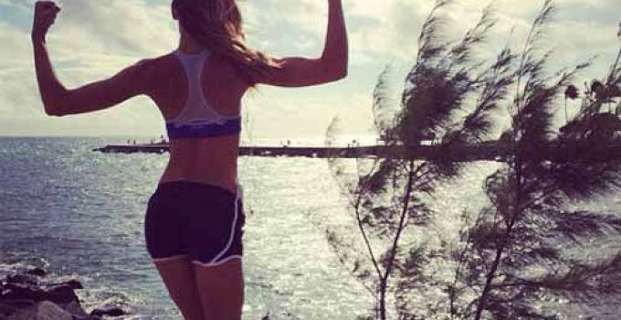 fit woman next to sea