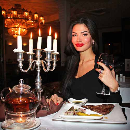 professional photo of woman at a dinner table
