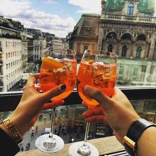 dimavika on a terrace with wine glass