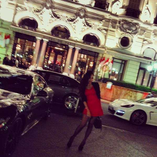 elegant girl next to hotel de paris monaco