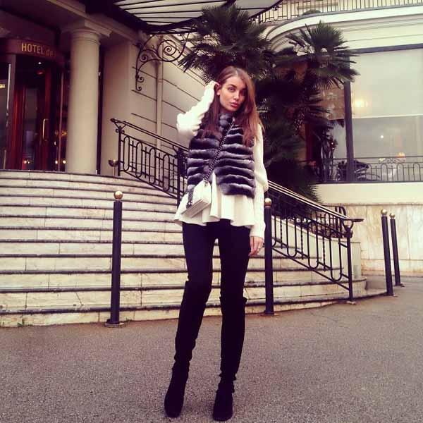 elegant lady standing next to hotel de paris