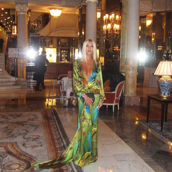 elegant woman standing in hotel de paris monaco