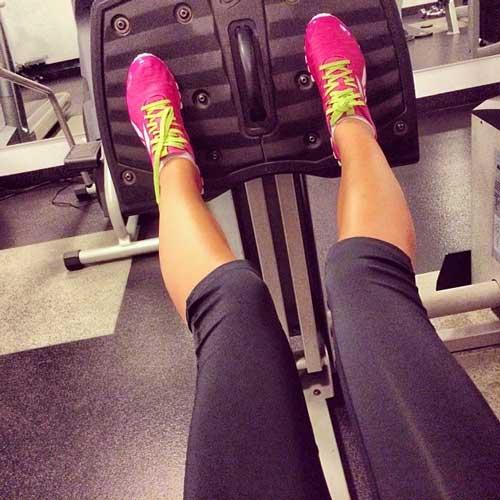 fit woman doing leg presses