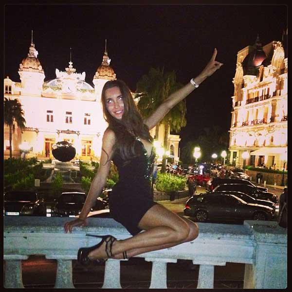 girl jumping next to mhotel de paris monaco