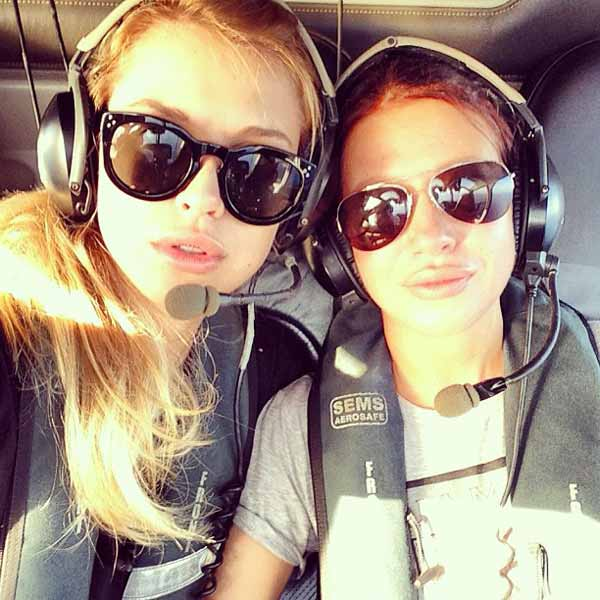 two elegant girls in helicopter
